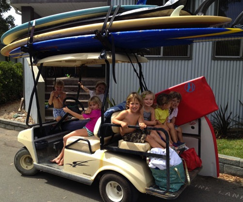 Kids In Surfboard Laden Car
